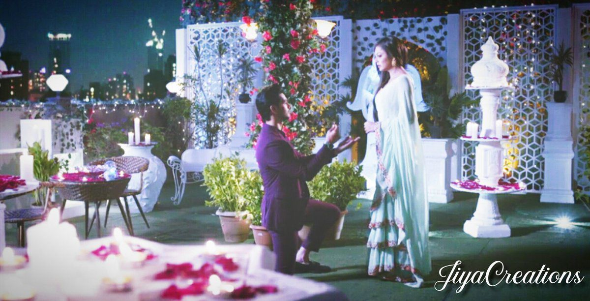 Nandini turn around feeling him behind her, Kunal sat down on his knees before her with a red rose in his hands