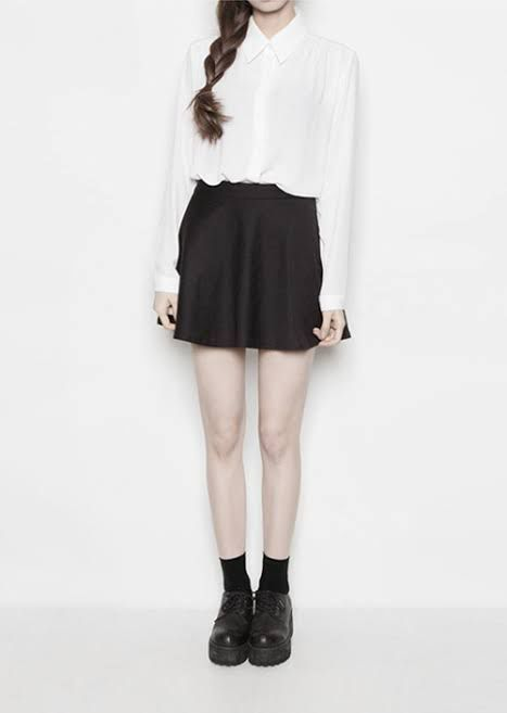 Just a simple white blouse that is tucked in a black skirt