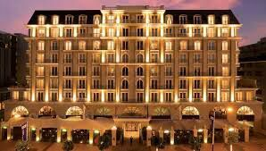 Calum holds my hand while we cross the street and go into a fancy looking hotel
