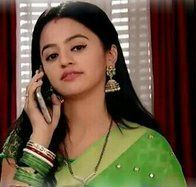 """ Swara said as her eyes were still fixed in her phone, she placed the phone on her ear as she dialled the phone"