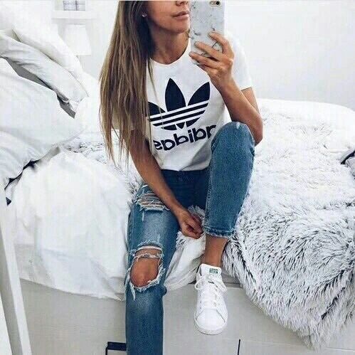 5) Ripped jeans, Adidas t-shirt