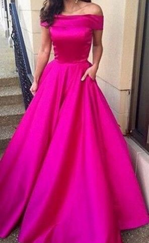 she pulls out a dress and she picked for Caroline it's a long flowy hot pink off the shoulders dress it's gorgeous totally something Caroline would wear