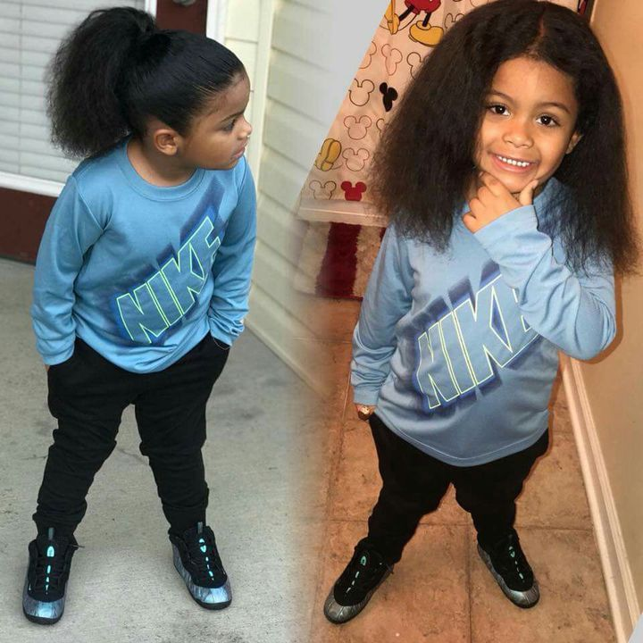 I washed him up and washed his hair then got him out and dressed in a blue Nike shirt and black joggers aND blue foamposits i took a picture of him with his hair down then pulled it up in a ponytail