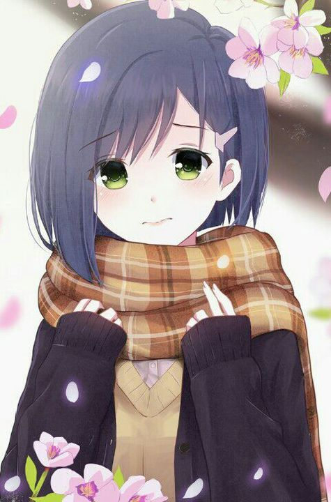 A girl with black hair with green eyes(?)