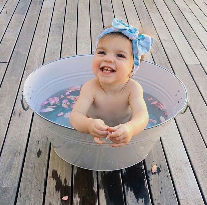 parkinsonriles I leave her with Chris for one minute and he's using a bucket as a bathtub  #IThoughtHeWasGoodAtParenting