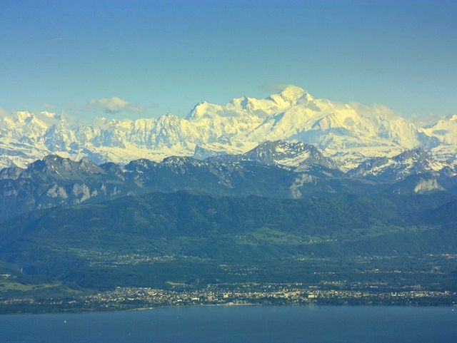 He alternated his eyes between the Mont Blanc Range and the edge of the stand of trees as he waited