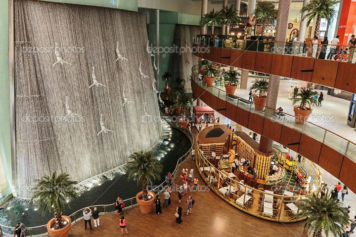 As soon as the doors opened, we were greeted with a giant waterfall in the center of the food court, with almost every kind of food shop you can think of