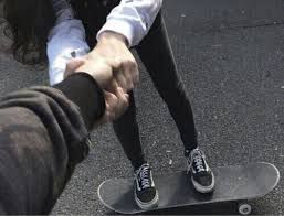Frustrated as both boys laugh at me I get off the skateboard, pick it up and start walking away