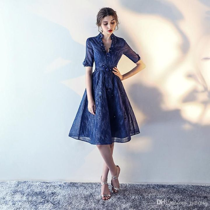 I entered my bedroom and walked to my walk-in closet I choice a navy-blue knee length dress, with sleeves to the elbow and lace covering the fabric, it had a V-neckline