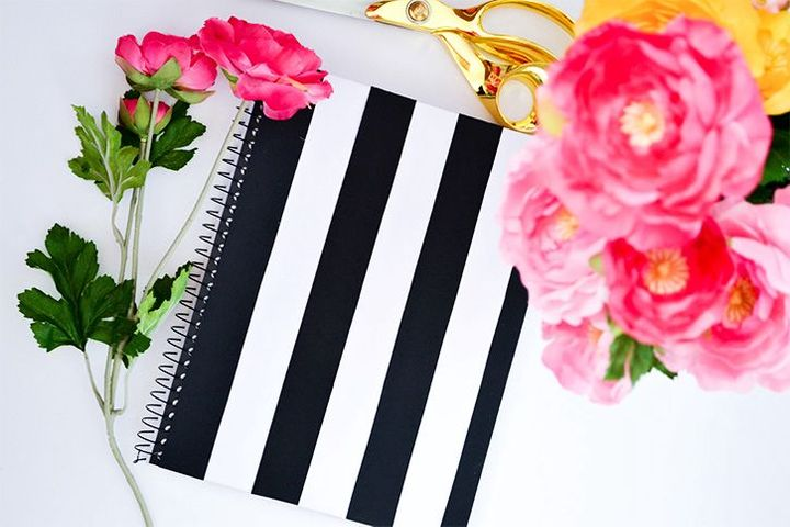 Once you have enough stripes, glue them onto your notebook