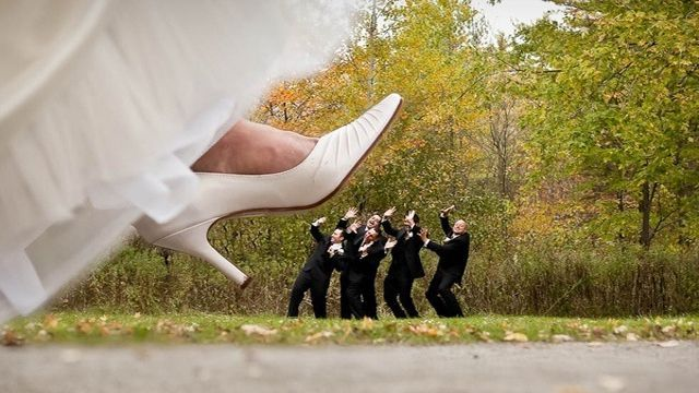 BEST MAN'S BEING STEPPED ON BY THE BRIDE:
