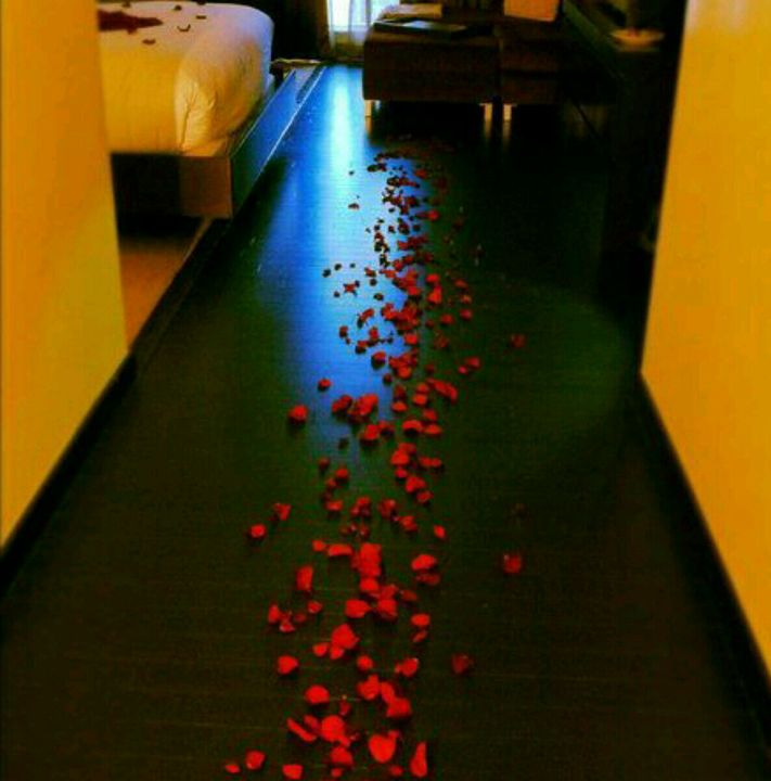 A series of rose petals were spreaded on the floor which was leading to