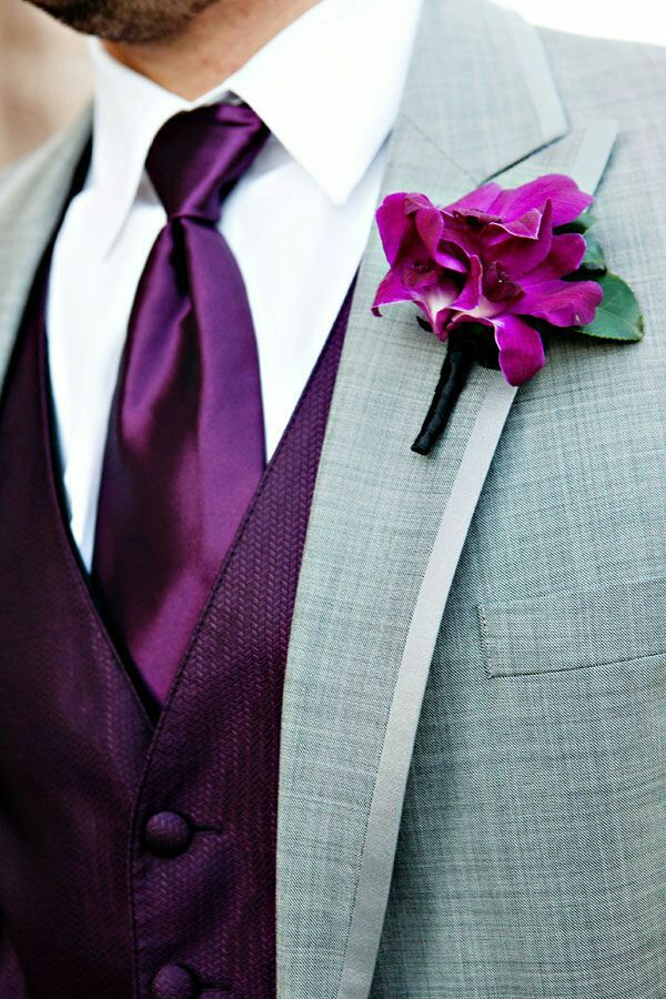 I was wearing a grey suit with a purple shirt to match the decoration