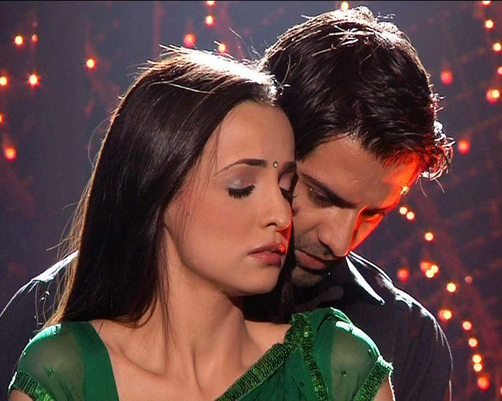 Khushi closed her eyes felling his cheeks caressing with her and his palm pressing on her bare skin