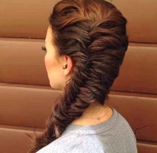 And then quickly braided her hair into a fish tail braid