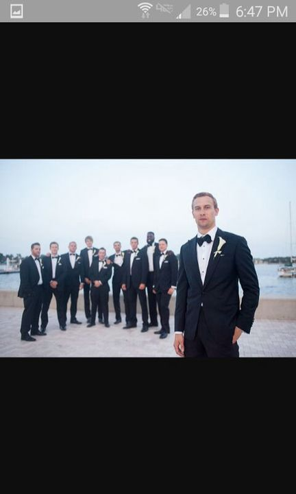Connors tux and the groomsmens are behind him