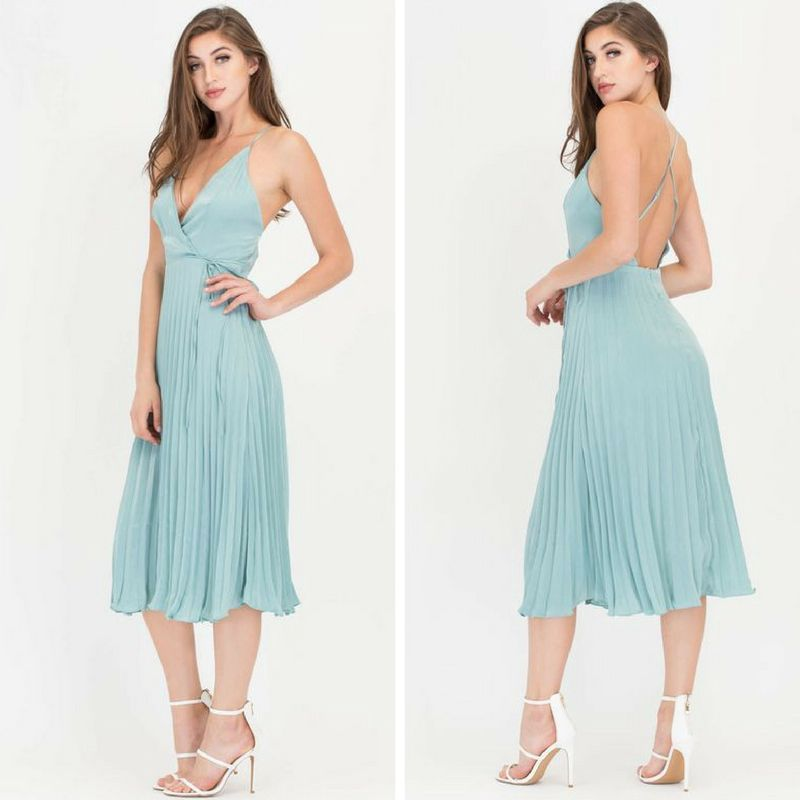 Sharon's outfit, front and back, is a plunging v-neck line, with spaghetti straps and pleated skirt: