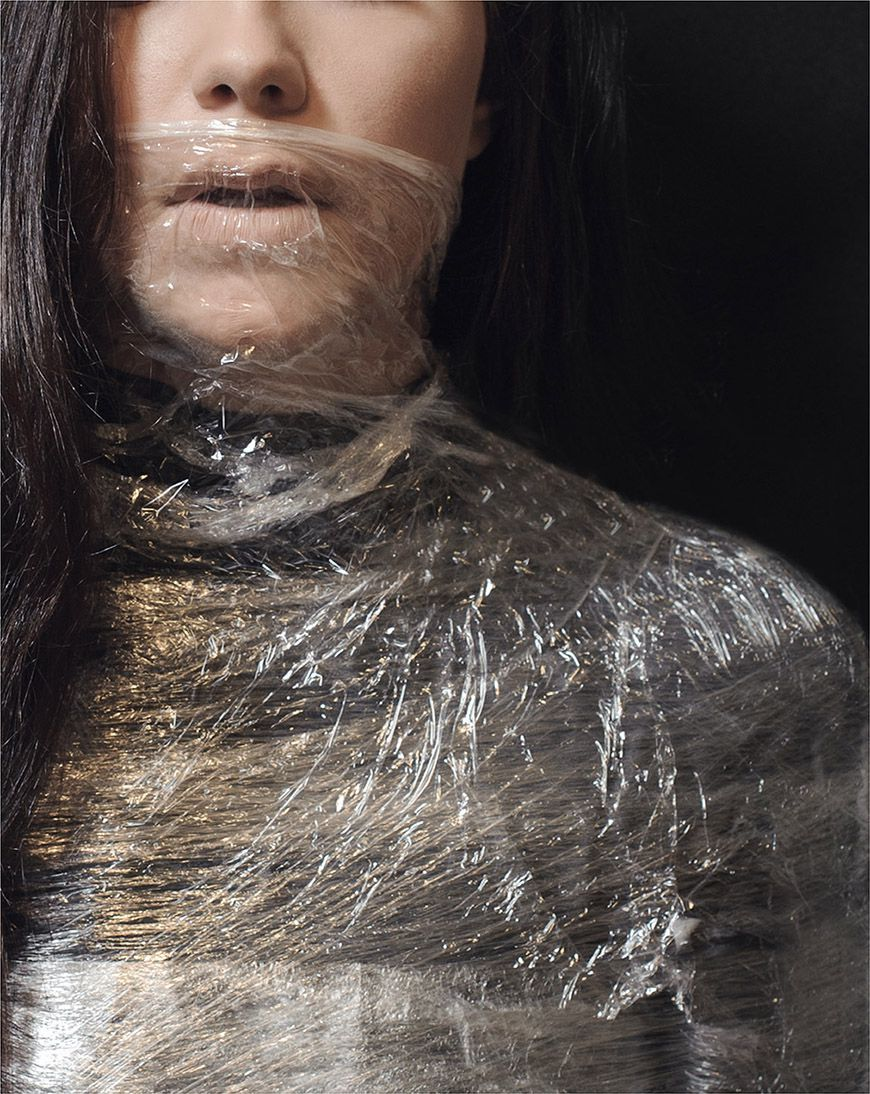 And she reached up, wrapping the Saran wrap around her mouth