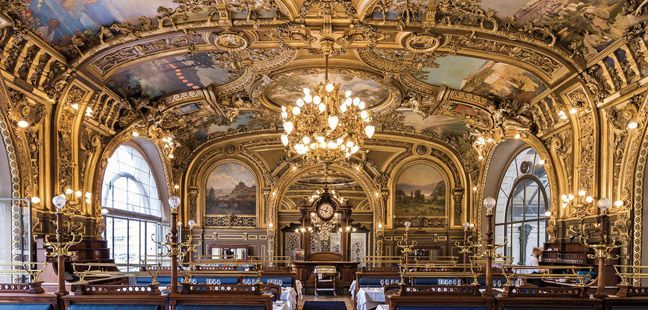 As the young woman placed menus and cartes on the table, David asked about the building and the ornate interior