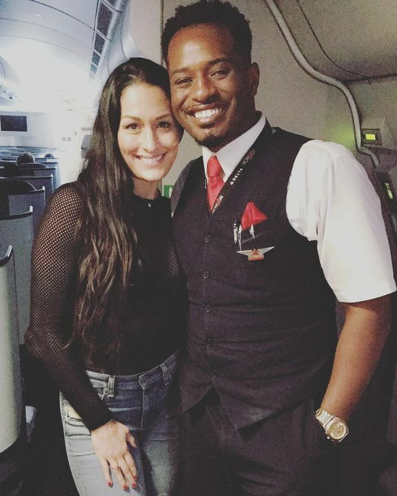 The WWE star was snapped flying economy with Delta's as she boarded a flight from Scottsdale, Arizona to London, England