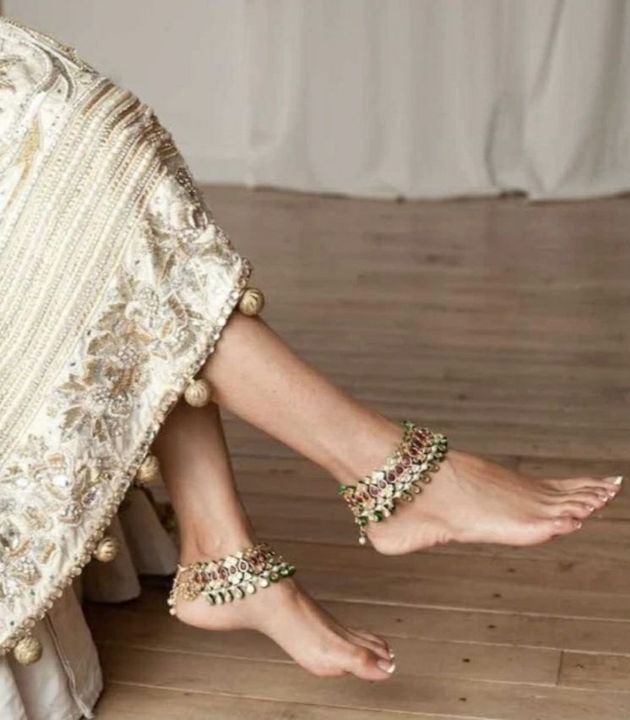 She got up slowly smiling and he took her feet up and placed a small kiss making her toes curl up with his affection