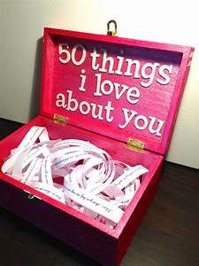 I see this pink rectangle lock box that has my name of top of it and on the inside it says 50 things I love about you with paper strips on the inside