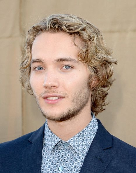 Toby Regbo as Charlie Hill