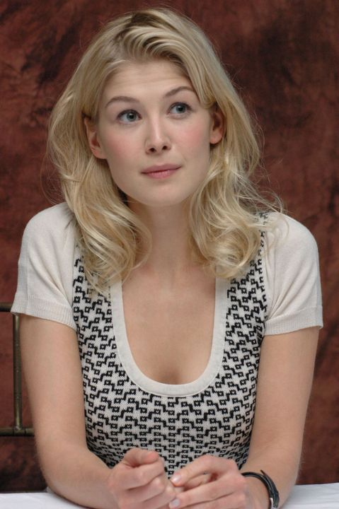 Rosamund Pike as Karina