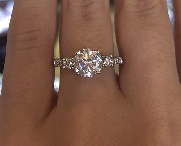 A/n Okay I couldn't find cute pictures with kinda the same ring sooooo this is the ring: