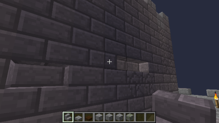 To break the symmetry, you can make a few bricks on the wall appear with the help of a ladder.
