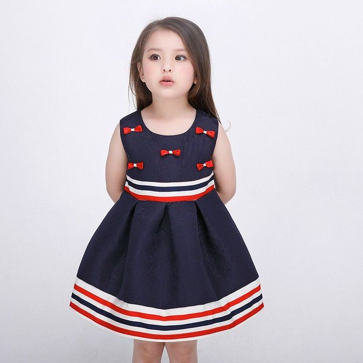 """""""Okay"""" I helped faith zip up her nay blue dress with red and white stripes and red bows"""