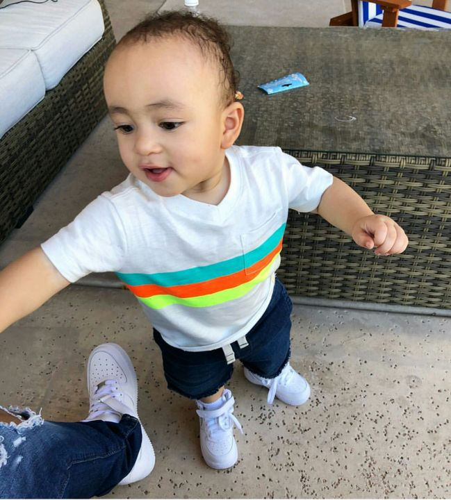 I rarely talk to Skies cause he's always busy or high but it's always good to here his voice I finished cleaning and took Dominic upstairs and got him dressed I took him in the closet with me and grabbed his white blue orange and neon Yellow shirt...