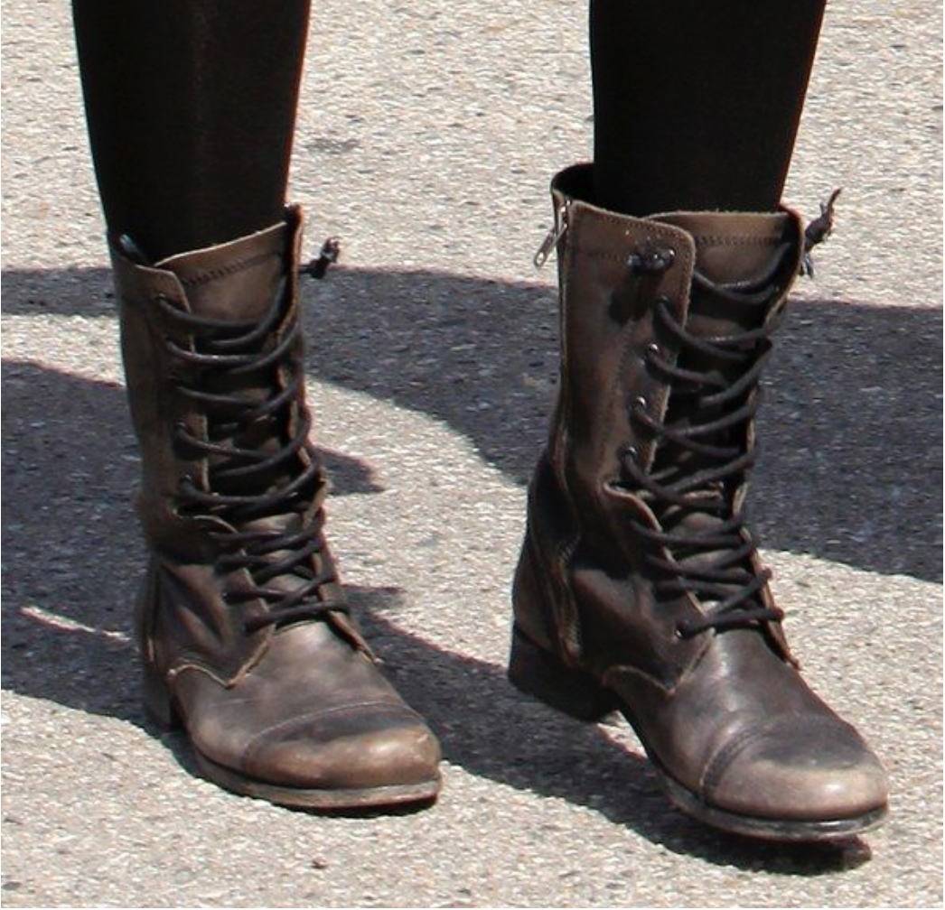 The girl had dark brown, if not black, combat boots that stopped at least 4 inches above her ankles