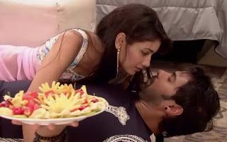 Pragya slowly lifts her hand and touches his face and starts to touch sensuously